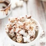 Spicy Chocolate Popcorn is light, airy, and crunchy. Drizzled with sweet melted chocolate with a spicy kick from cayenne pepper and a sprinkling of sea salt. Addicting snack | Imagelicious