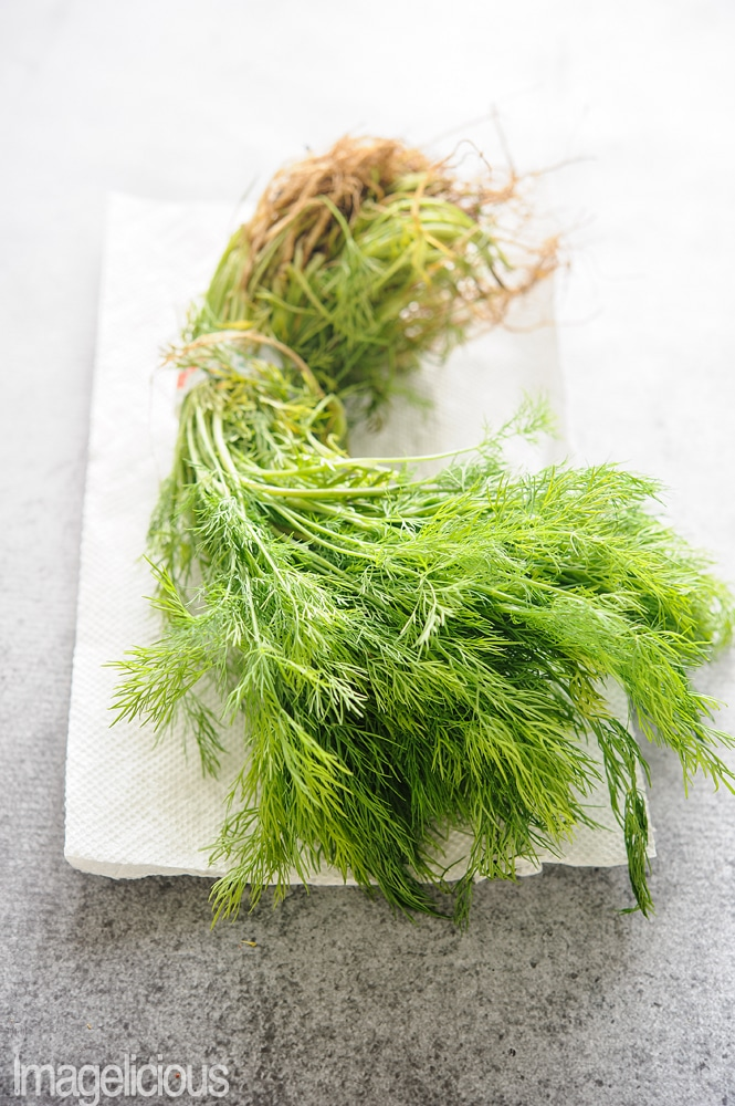 A bunch of dill on a paper towel