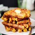 Ricotta and Pumpkin Waffles are perfect for brunch in the fall. Pumpkin melts into the batter and ricotta gives the pancakes a slightly tangy flavour. Crisp edges provide a jarring contrast to the soft and airy middle. Cinnamon, ginger, vanilla, and cloves make the waffles comforting and familiar | Imagelicious
