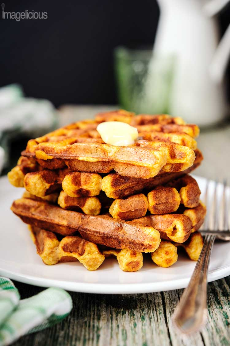 Ricotta and Pumpkin Waffles are perfect for brunch in the fall.Pumpkin melts into the batter and ricotta gives the pancakes a slightly tangy flavour.Crisp edges provide a jarring contrast to the soft and airy middle. Cinnamon, ginger, vanilla, and cloves make the waffles comforting and familiar | Imagelicious