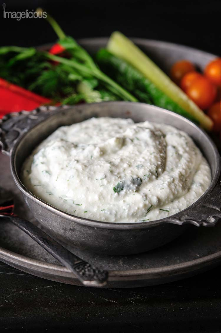 Closeup of a bowl of Cottage Cheese Dip with vegetables