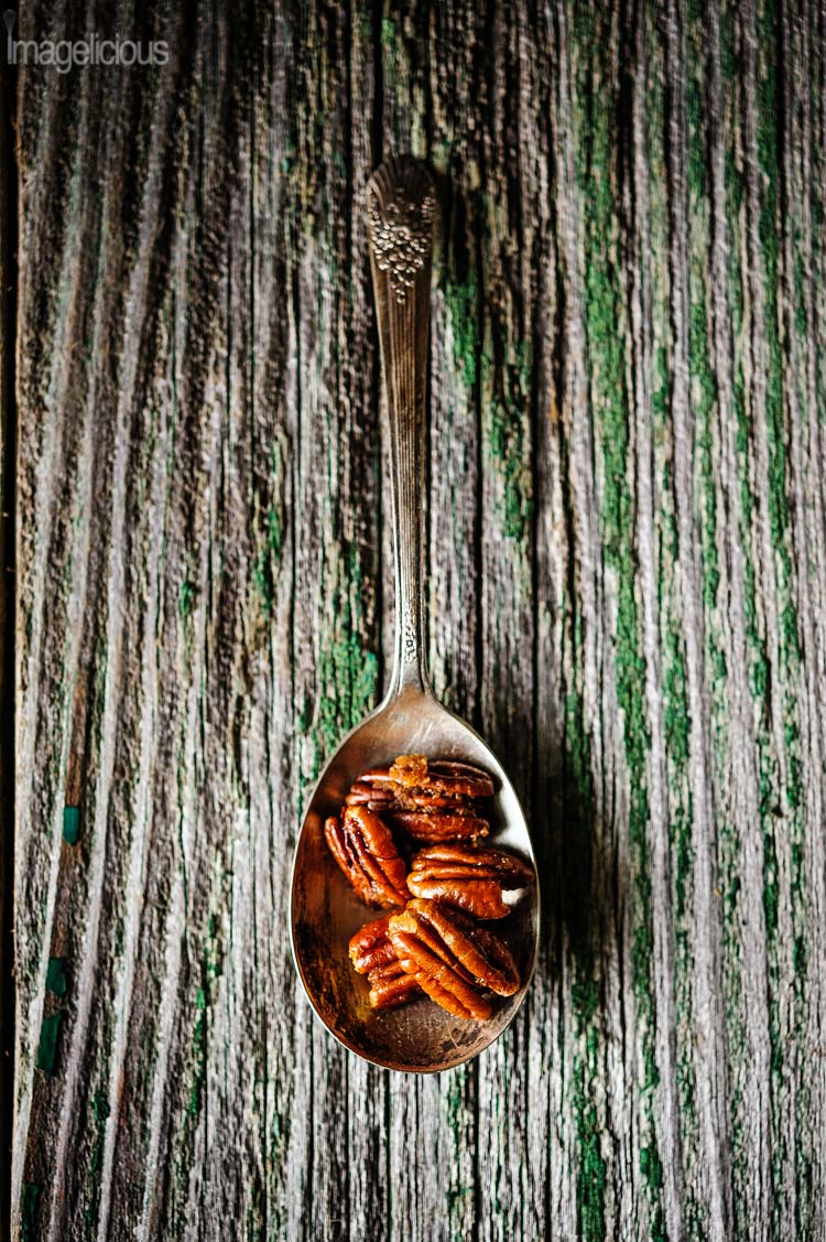 Spiced Caramelized Pecans in one spoon