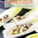 Easy and quick endive appetizer with blue cheese, pecans, and cranberries is a delicious and elegant appetizer for a weeknight dinner or a big party. It takes only minutes to make and can be prepared in advance | imagelicious.com #endive #appetizer #party