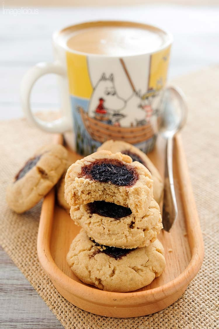 These soft and thick Brown butter, peanut butter and jam cookies are a delicious treat for a weekday snack or a weekend dessert. Dense cookie with sticky sweet jam is a perfect combination of flavours and textures | Imagelicious