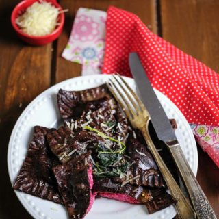 These Chocolate Ravioli with Ricotta-Beet Filling are beautiful, delicious, and healthy. Perfect for the Valentine's Day dinner or any other lazy weekend. Serve with brown butter sage sauce or just with a sprinkling of parmesan cheese | Imagelicious
