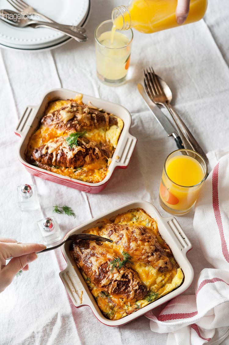 Smoked Salmon Croissant Strata is a perfect brunch dish to make during holidays. Elegant, savoury and a little bit indulgent it's a sure way to please everyone at the table without breaking a bank | Imagelicious