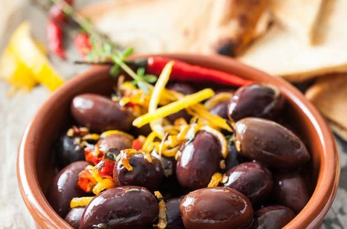 Lemon Baked Olives are wonderfully spicy and earthy with bright lemon, thyme and chili flavours | Imagelicious