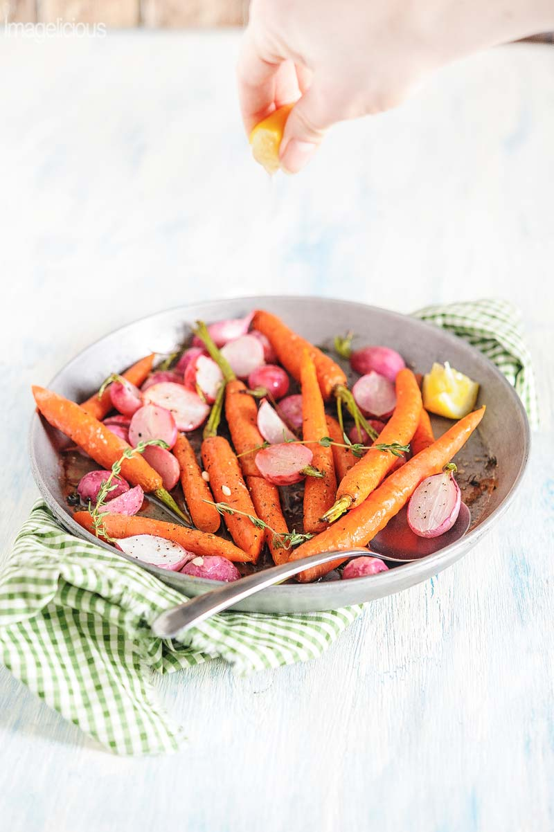 Roasted Radishes and Carrots with Thyme and Lemon are fresh, buttery and earthy. Delicious as a spring side dish or on top of mixed green leaves as salad | Imagelicious