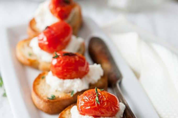 Tomato-Ricotta Bruschetta - crusty baguette topped with creamy ricotta and tangy tomatoes | Imagelicious