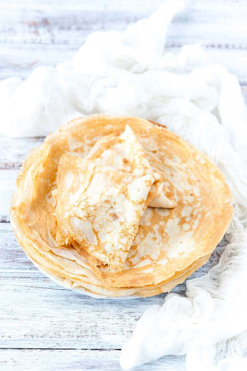 These Traditional Russian Crepes or blini are delicious to have for breakfast with maple syrup or your favourite jam and yogurt. You can also stuff them with ricotta or make them savoury serving them with smoked salmon or cheese | Imagelicious