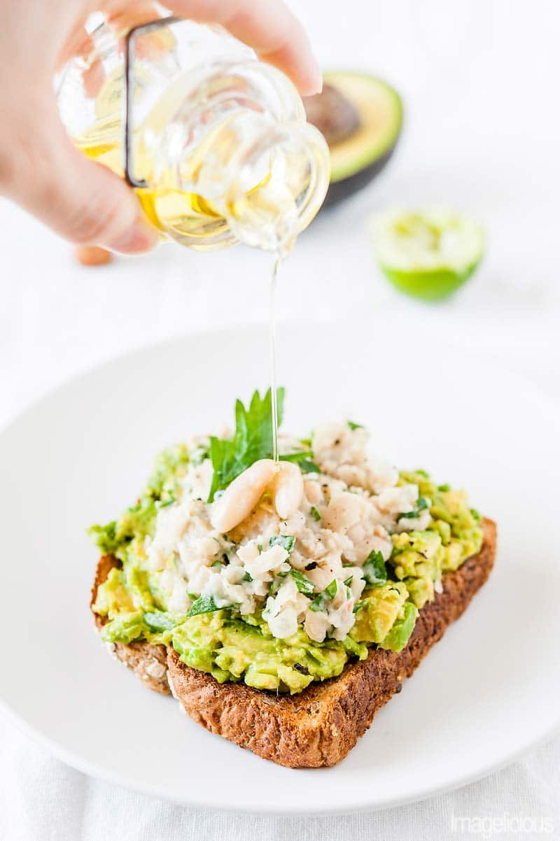 Avocado-White Kidney Beans Toast is a delicious and healthy breakfast, lunch, or even light dinner. It comes together in a matter of minutes and keeps you full for hours. Perfect for any time of the year and easy to make. Pair it with a Salad and you have a complete meal | Imagelicious