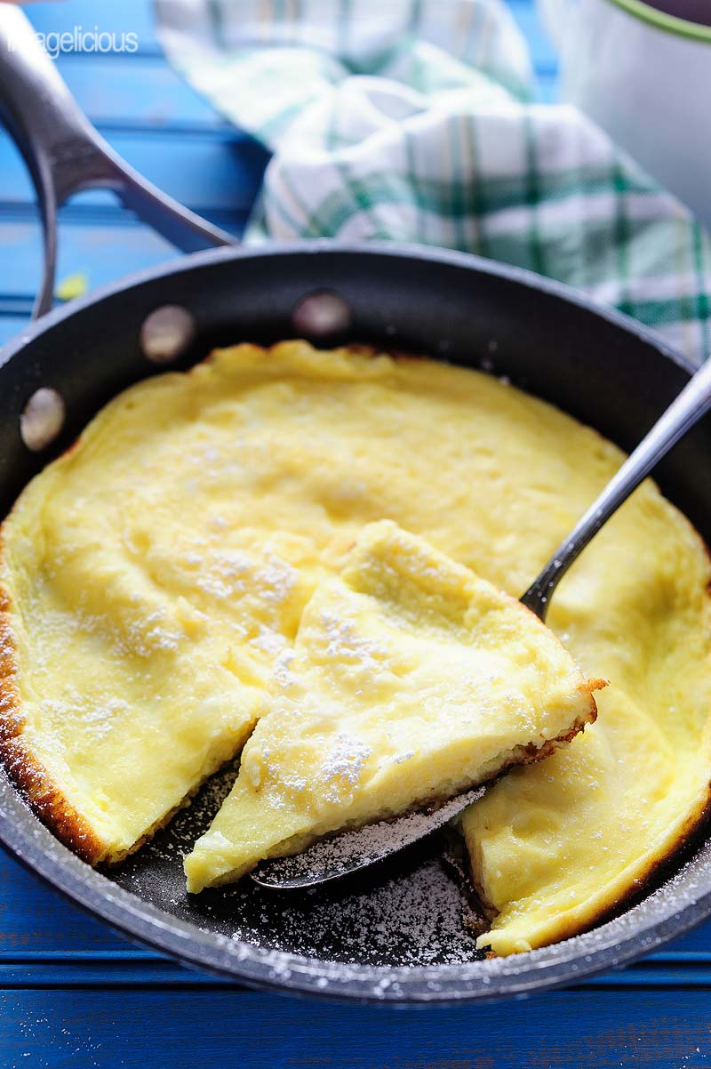 Pan with sweet omelet and a slice cut out and on a spatula
