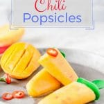 Mango Orange Chili Popsicles are sweet, spicy, and refreshing. Great way to cool down in the summer. Chili pepper adds a fine spicy note to sweet fruit. Naturally sweet, vegan, raw, gluten-free | Imagelicious #glutenfree #vegan #raw #mango #popsicles #frozen #spicy