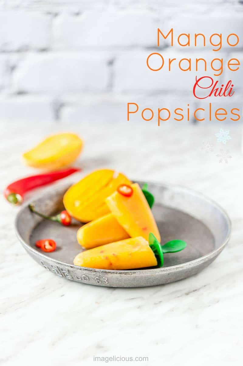Mango Orange Chili Popsicles are sweet, spicy, and refreshing. Great way to cool down in the summer. Chili pepper adds a fine spicy note to sweet fruit. Naturally sweet, vegan, raw, gluten-free   Imagelicious