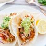 Pulled Pork Tacos are a great way to use up some leftover pulled pork. It's a fun meal that everyone will love. Add cheese, guacamole, and cilantro for a delicious medley of flavours. Great for picnics, family dinners, or busy evenings   Imagelicious