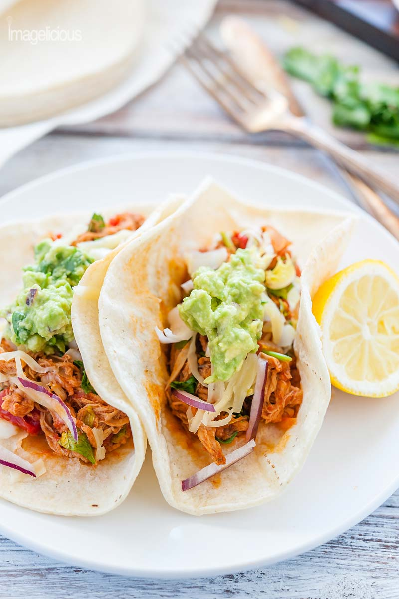 Closeup of two Pulled Pork Tacos in flour tortillas