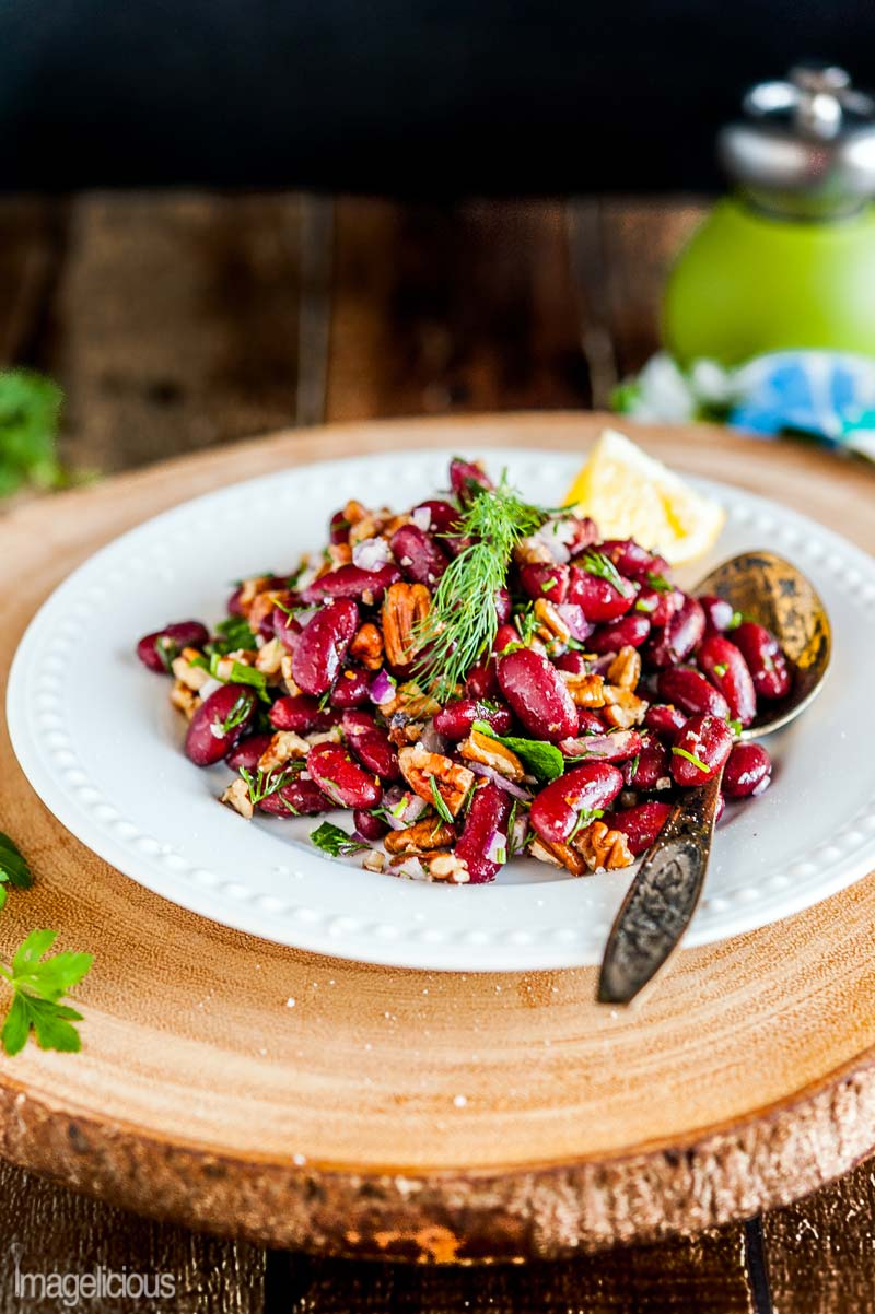 Bean and Pecan Salad is perfect for summer picnics or potlucks. It's made only with a handful of ingredients but has a really bright and vibrant flavour. It's healthy, filling, naturally gluten-free and vegan | Imagelicious