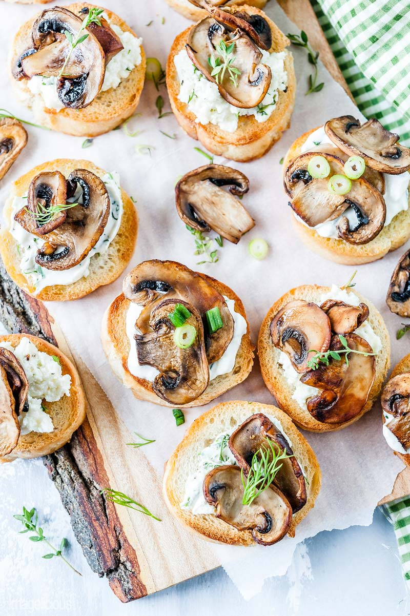 Closeup of a top down view of many Mushroom Crostini on a cutting board