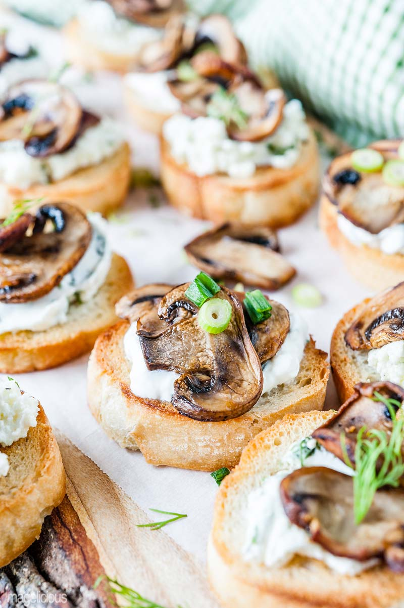 Mushroom Crostini with Sour Cream and Green Onion is delicious and elegant appetizer that is really easy to make and is perfect for any time of the year | Imagelicious