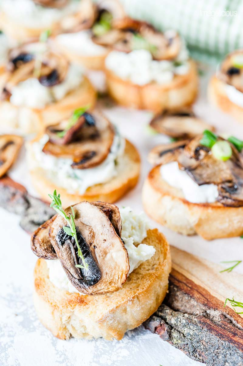Close up view of a ricotta and thyme Mushroom Crostini