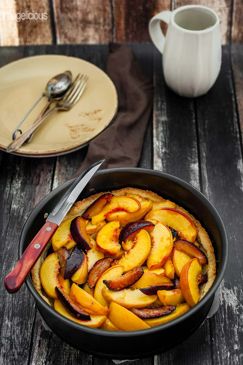Peach-Plum Almond Tart is deliciously crumbly and nutty, perfect accompaniment to peaches and plums. Great to enjoy during summer with some cold whipped cream | Imagelicious