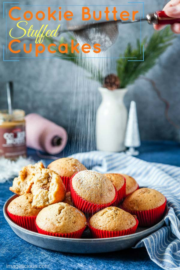 These Cookie Butter Stuffed Cupcakes are soft, fluffy, spicy, and delicious. Filled with delicious cookie butter, they are a perfect treat during Christmas Holidays | Imagelicious #CookieButter #Cupcakes #Desserts #ChristmasBaking #Speculaas
