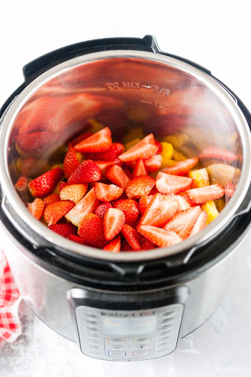 Instant Pot with strawberries and frozen peaches