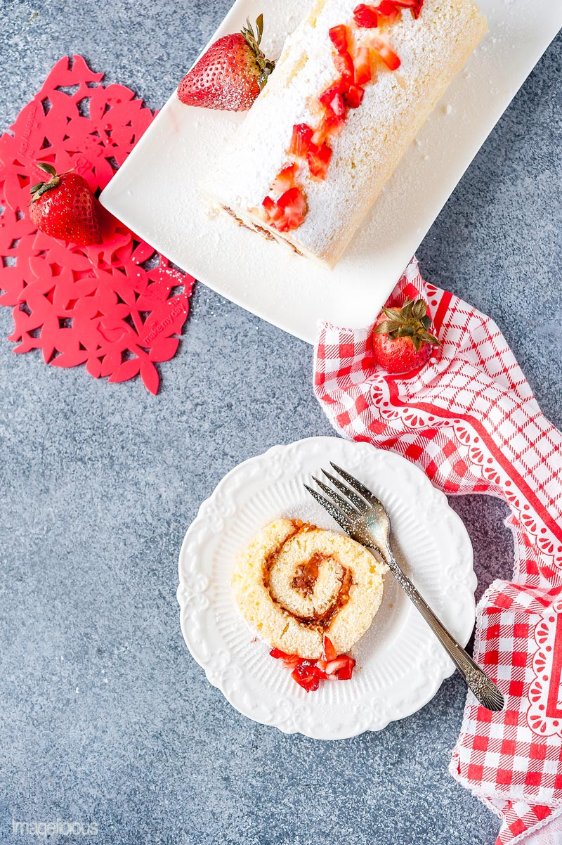 Top down view of a 3-ingredient cake roll with strawberry jam