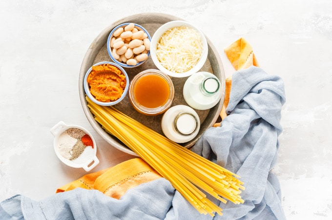 Top down view of all the ingredients to make Instant Pot Pumpkin Fettuccine Alfredo