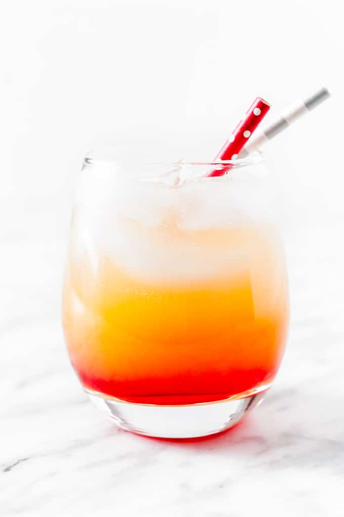 Glass of Sparkling Campari Orange with two straws