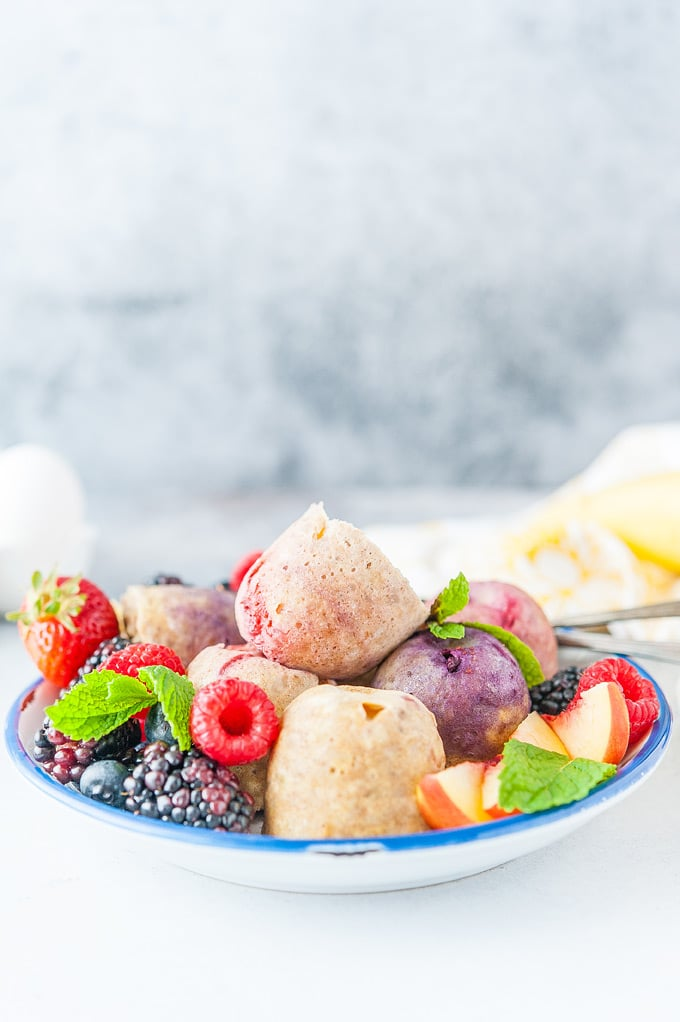 Closeup of a plate of Instant Pot Fruity Egg Bites with berries and fruit