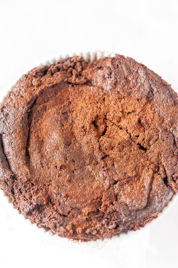 Top down view of a whole Instant Pot Brownie dusted with cocoa powder