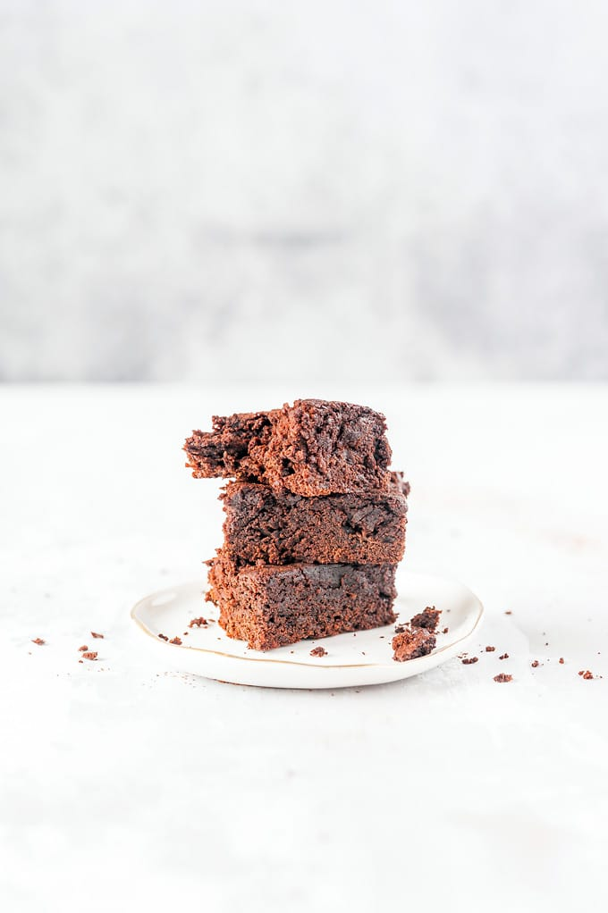 A stack of three Instant Pot Brownies on a plate