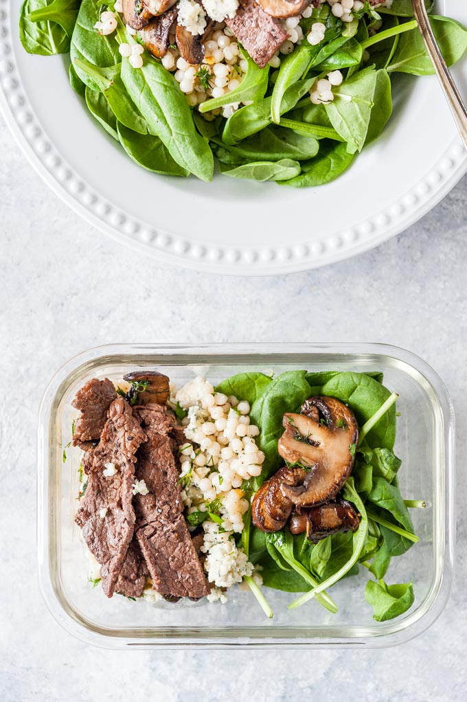 Steak and Mushroom Salad in a meal prep container and in a serving bowl