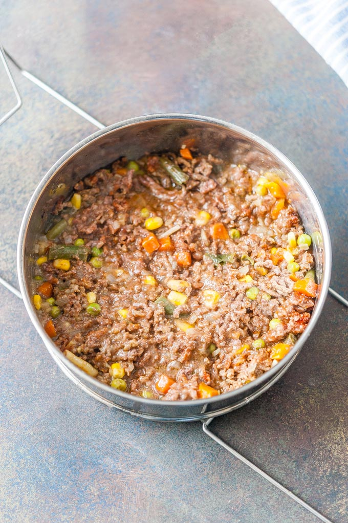 Shepherd's Pie meat layer cooked in a stackable insert pan