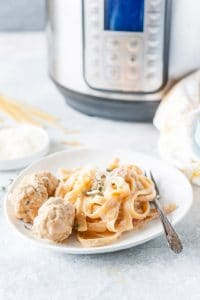 Plate with Instant Pot Creamy Pasta and Meatballs