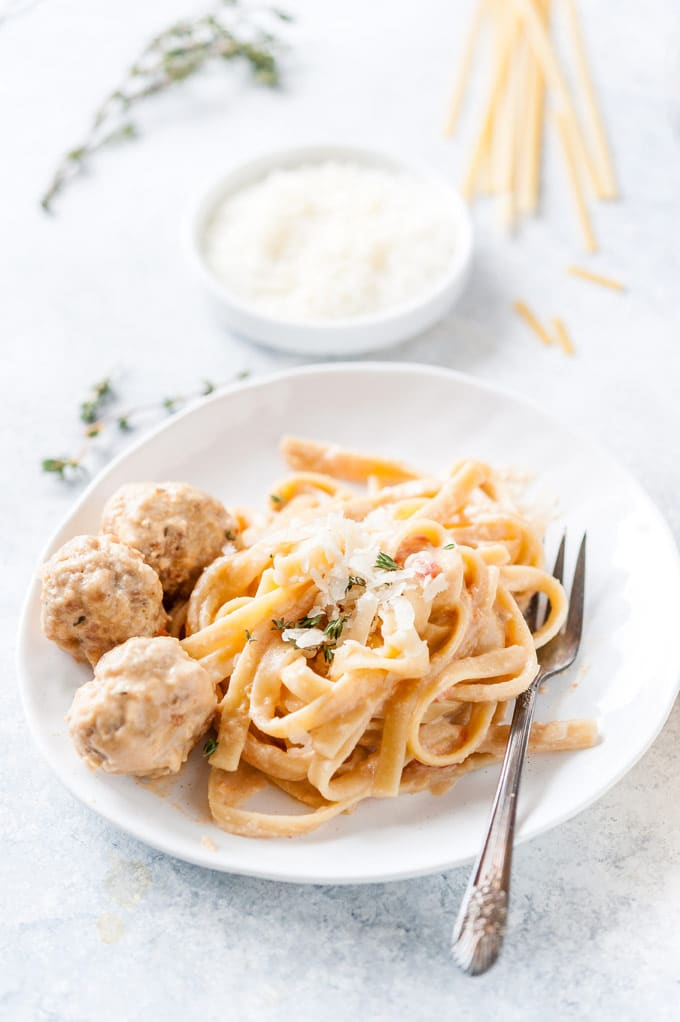 Closeup of a plate with Instant Pot Creamy Pasta and Meatballs