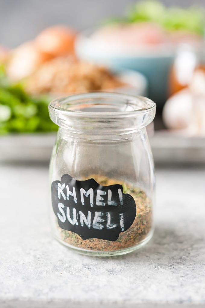Jar with Khmeli Suneli label and spices inside