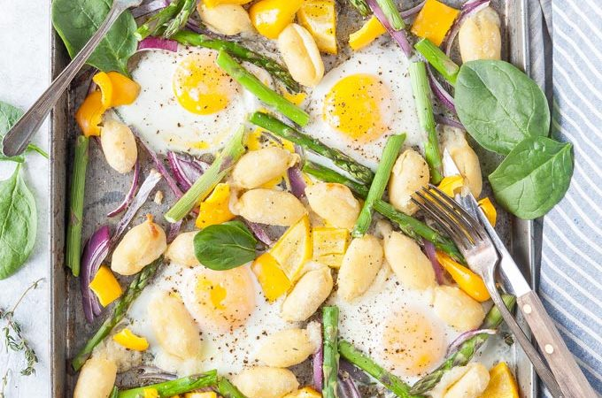 Cooked Gnocchi and Eggs with vegetables on a sheet pan