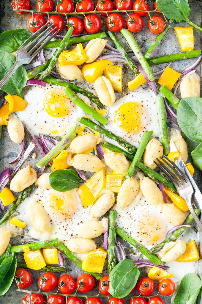 Top down view of a Sheet Pan Gnocchi and Eggs breakfast