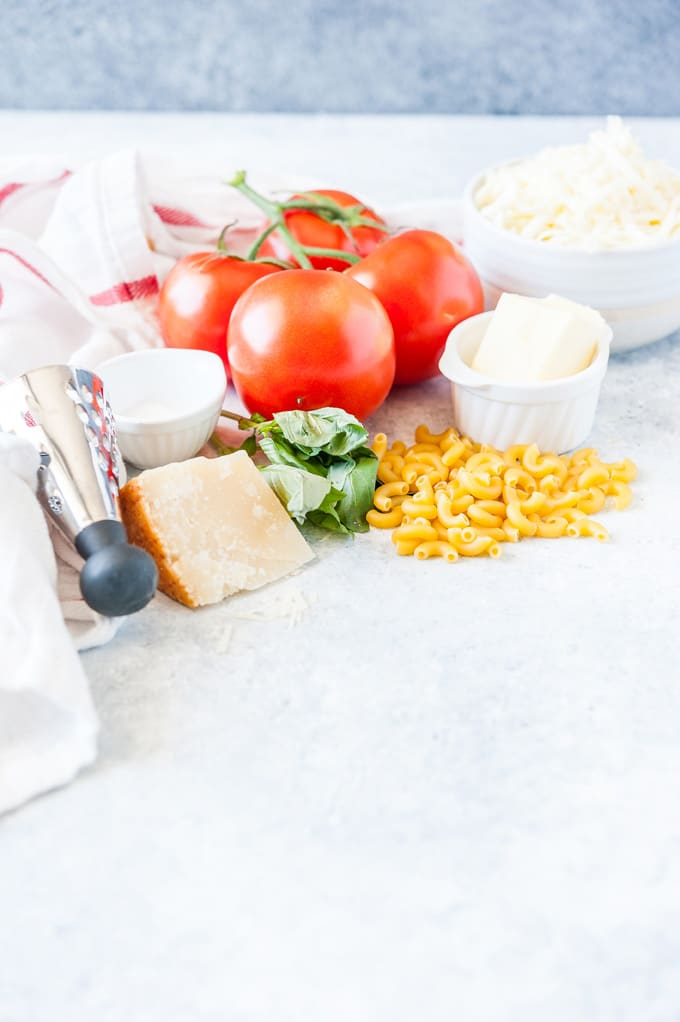All the ingredients to make One Pot Caprese Macaroni and Cheese pasta.