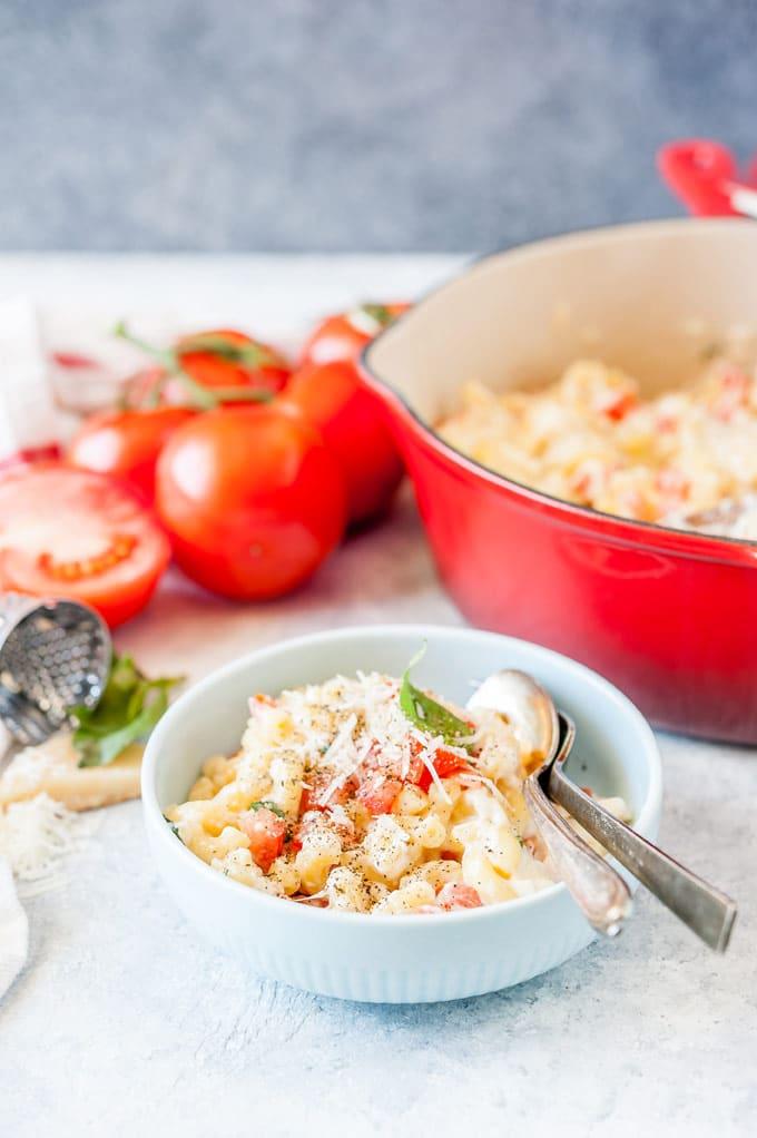 Bowl of Caprese Macaroni and cheese.