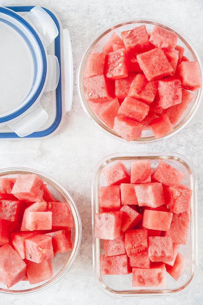 Three meal prep containers with cut up watermelon.