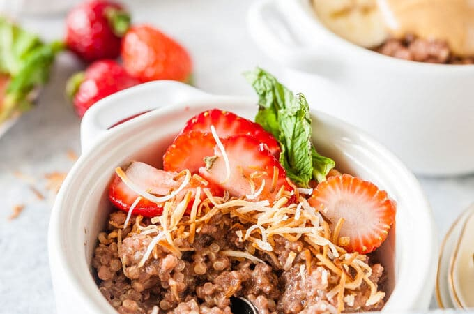 Close up of Chocolate quinoa with strawberries and toasted coconut.
