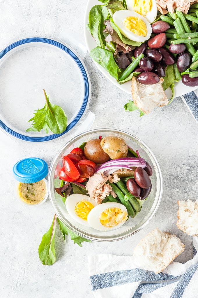 Meal prep bowl with Nicoise Salad and the rest of the salad on a platter.