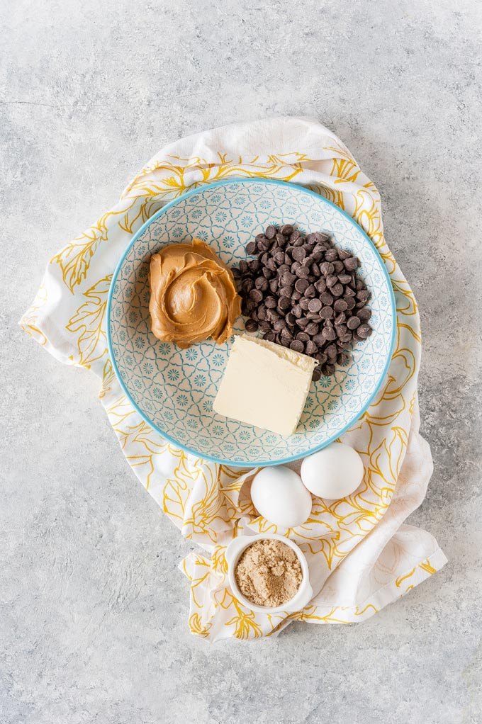 All ingredients to make flourless chocolate peanut butter cakes.