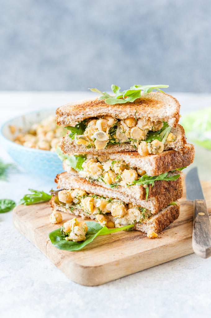 Stack of chickpea salad sandwiches.