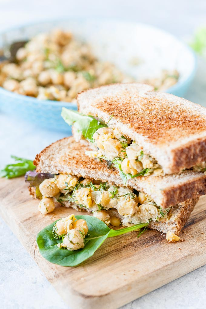 Two vegetarian chickpea salad sandwiches.