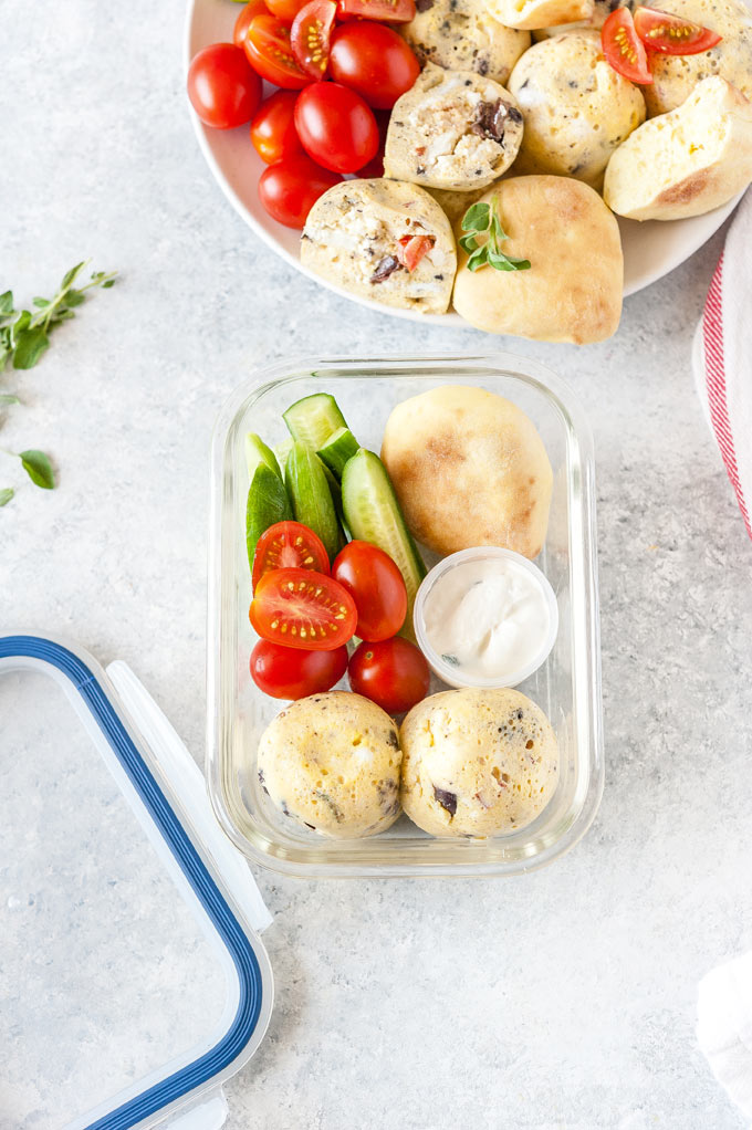 Meal prep container with instant pot greek salad egg bites.