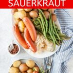 Instant Pot Sausage and Sauerkraut with potatoes and green beans is a simple and comforting one-pot meal for a busy night. Affordable and with minimal prep. Easy and delicious | imagelicious.com #instantpot #sausages #sauerkraut